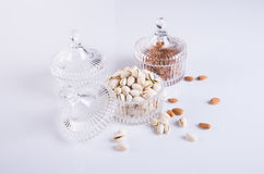 Almonds and pistachio in glass bowl on a background. Royalty Free Stock Photo