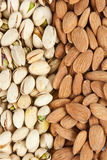 Almonds and pistachios background vertical Royalty Free Stock Photo