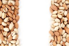 Almonds and pistachios borders Royalty Free Stock Photos