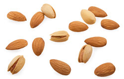 Almonds and pistachios are scattered. On a white background Royalty Free Stock Image