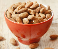 Almonds. Placed in a red bowl,healthy fruits Stock Images