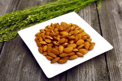 Almonds on the plate Royalty Free Stock Images