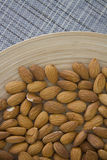 Almonds on plate Royalty Free Stock Photos