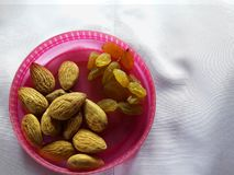 Almonds and raisins in a bowl. stock photography
