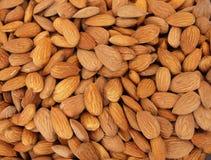 Almonds. Raw fresh organic almond nuts. Almond background. Nuts background. Almond texture and background Royalty Free Stock Image