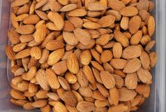 Almonds. Raw fresh organic almond nuts. Almond background. Nuts background. Almond texture and background Royalty Free Stock Images