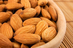 Almonds. Raw almonds in wooden bowl close-up Stock Image