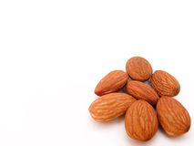Almonds in right corner Royalty Free Stock Photo