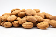 Almonds with rind Stock Photography