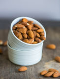 Almonds roasted in ceramic bowl Stock Photo