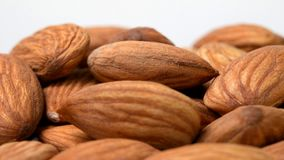 Almonds rotating close-up on white. Background stock footage