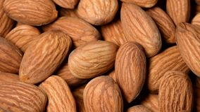 Almonds rotating top view. Close up stock video