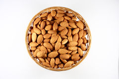 Almonds in a round basket royalty free stock images