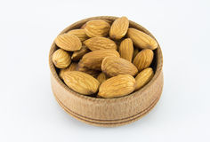 Almonds in a round wooden form Royalty Free Stock Photography
