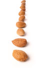 Almonds. In a row on a white kitchen table stock photo