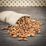 Almonds on rustic wooden background Royalty Free Stock Image
