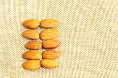 Almonds on sack  background Royalty Free Stock Image