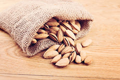 Almonds on sack bag Royalty Free Stock Images