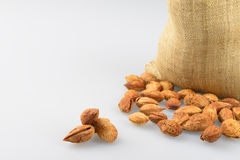 Almonds and sacks Royalty Free Stock Image