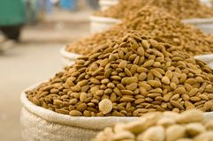 Almonds in sacs at the market Royalty Free Stock Photos