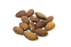 Almonds. With salt on  a white background Royalty Free Stock Images
