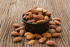 Almonds seed in black bowl Royalty Free Stock Photo