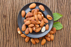 Almonds seed in black platel Stock Image