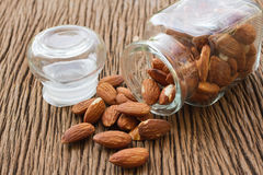 Almonds seed in glass bottle Stock Photo