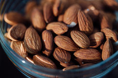 Almonds seed in the glass bowl. Royalty Free Stock Image