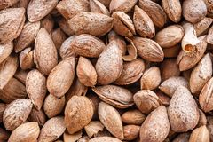 Almonds in a shell. As a texture Royalty Free Stock Photo