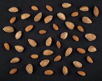 Almonds  in shell. Almonds in shell and kernels isolated on black. Raw food ingredients front view Stock Image