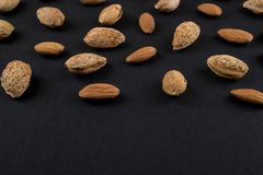 Almonds  in shell. Almonds in shell and kernels isolated on black. Raw food ingredients front view Royalty Free Stock Photos