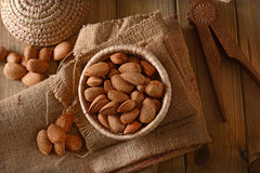Almonds in shell in the basket. Closeup Stock Photos