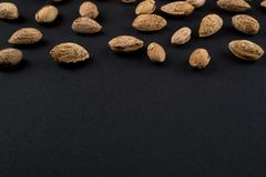 Almonds  in shell. Heap of almonds in shell isolated on black. Raw food ingredients Stock Photos