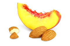 Almonds with slices of nectarine Royalty Free Stock Photos