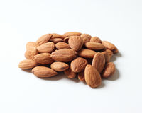 Almonds on a white background. A small pile of almonds isolated on a white background Royalty Free Stock Photography