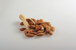 Almonds  with a small wooden spoon. Royalty Free Stock Image