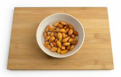 Almonds soaking in a bowl of water Stock Photos