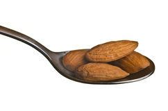 Almonds in a spoon Stock Image