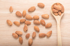 Almonds in spoon. Royalty Free Stock Image