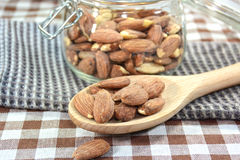 Almonds on spoon wooden. Stock Photo