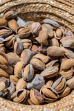 Almonds in a straw hat. Royalty Free Stock Images