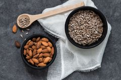 Almonds and sunflower seeds in black bowl. Whit some props royalty free stock image