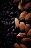 Almonds and sunflower seeds in chocolate on a dark background. Studio. Stock Photography