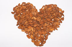 Almonds without their shells, making a heart. Shape Stock Photos