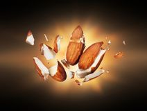 Almonds is torn to pieces close-up in the dark.  royalty free stock photos