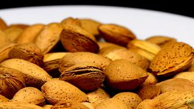 Almonds on a turn table. Unpeeled nuts stock video footage