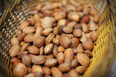 Almonds unshelled nuts in basket, fresh and raw. Healthy ingredient royalty free stock photos