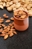 Almonds in a vessel, snacks of nuts Stock Photos