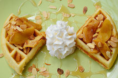 Almonds waffle with wipcream and cyrup. For breakfast Stock Photography